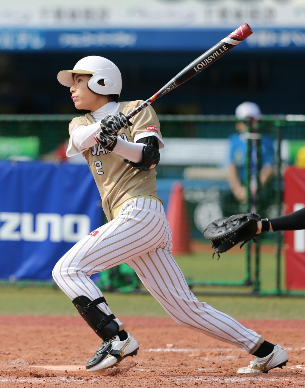 Japan's Saki Yamazaki hits an inside-the-park home run in the third inning during a women's world softball championship game against Canada, in Chiba,