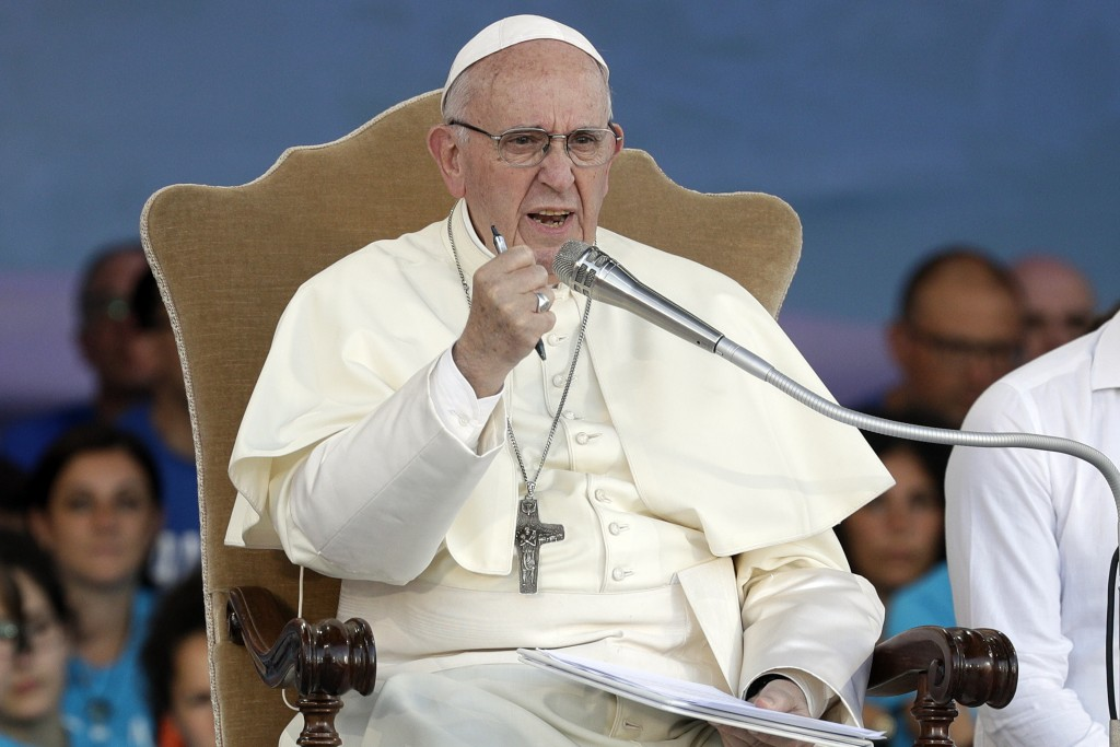 Pope Francis delivers his speech as he leads an evening prayer vigil with youths, at Rome's Circus Maximus, Saturday, Aug. 11, 2018. Thousand of youth...