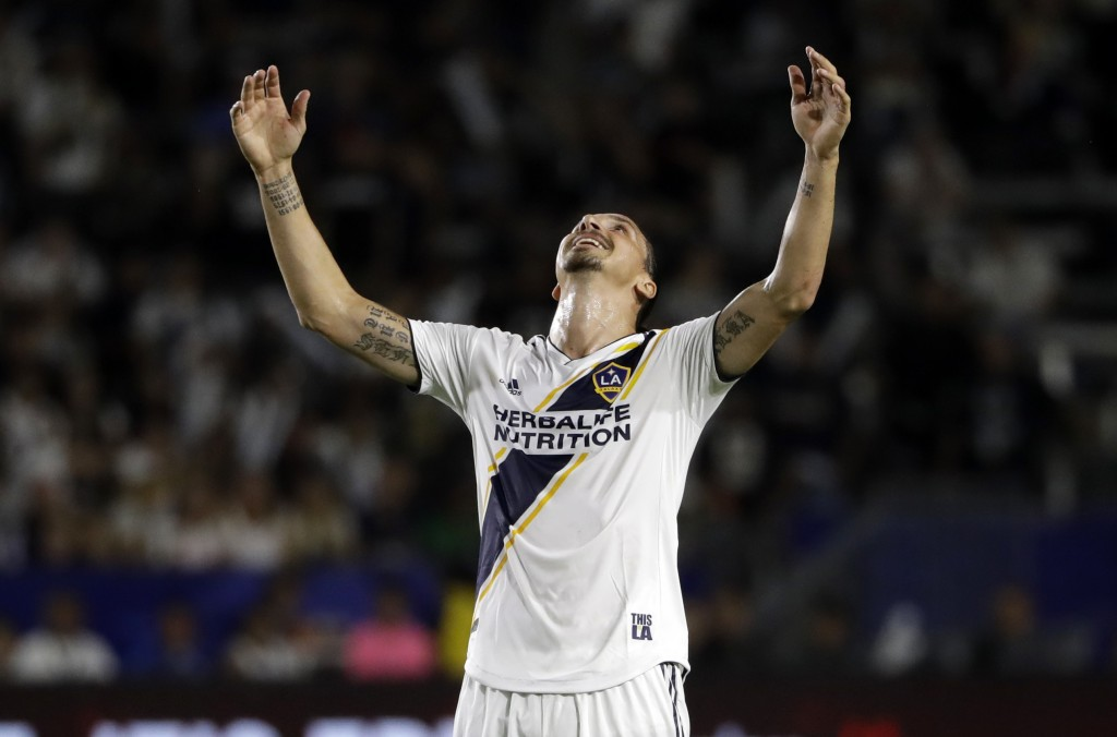 LA Galaxy forward Zlatan Ibrahimovic reacts to a missed shot during the first half of the team's MLS soccer match against the Minnesota United on Satu...