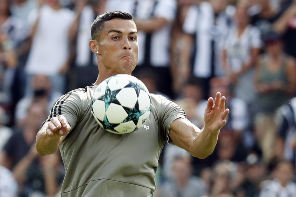 FILE - In this Sunday, Aug. 12, 2018 file photo Cristiano Ronaldo controls the ball during a friendly match between the Juventus A and B teams, in Vil...