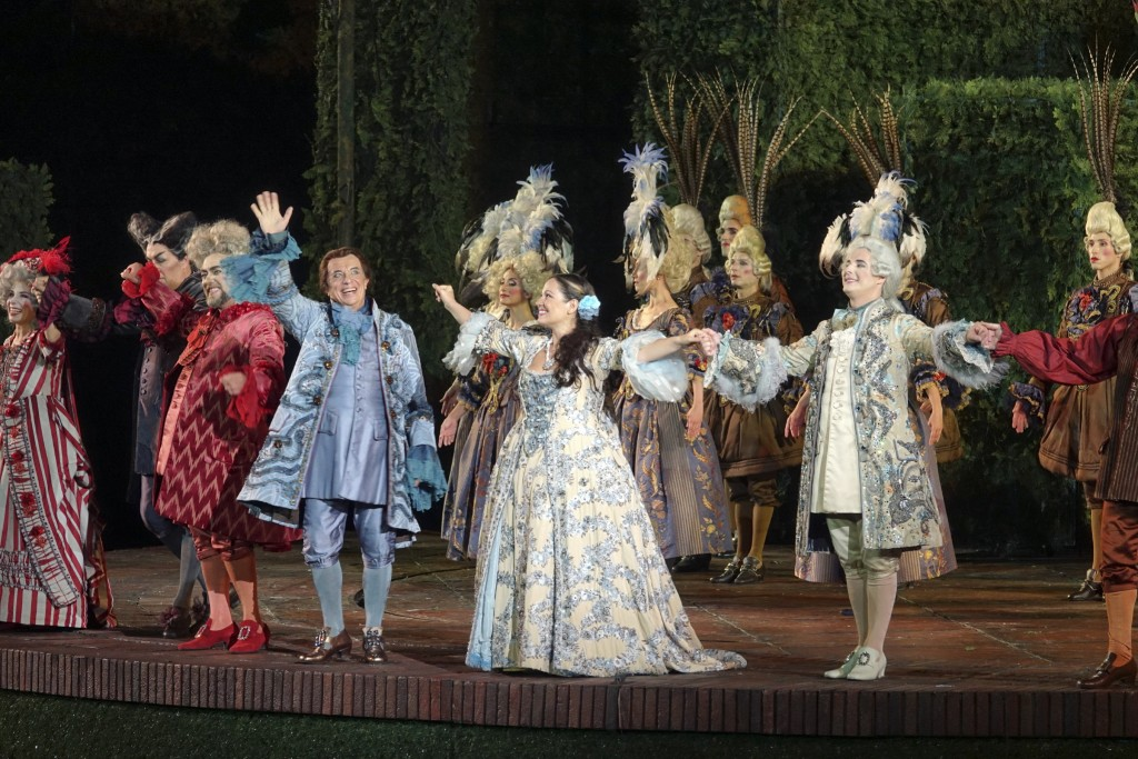 Italian baritone Leo Nucci, third from left, waves at the crowd after singing the title role in Rossini's ''Barbiere di Siviglia'' at the Verona Arena