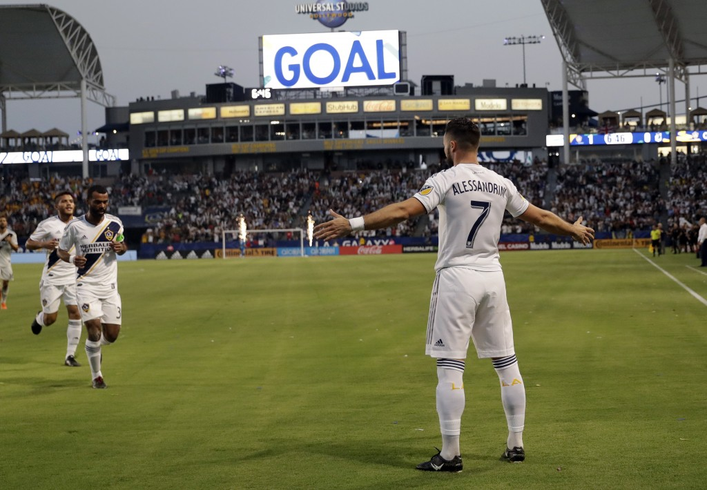LA Galaxy midfielder Romain Alessandrini (7) celebrates his goal against Minnesota United during the first half of an MLS soccer match Saturday, Aug. ...