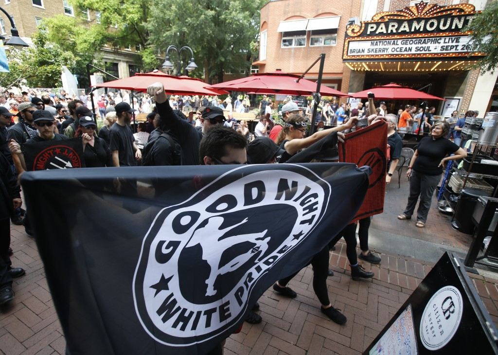 A group Anti-fascism demonstrators, march in the downtown area in anticipation of the anniversary of last year's Unite the Right rally in Charlottesvi