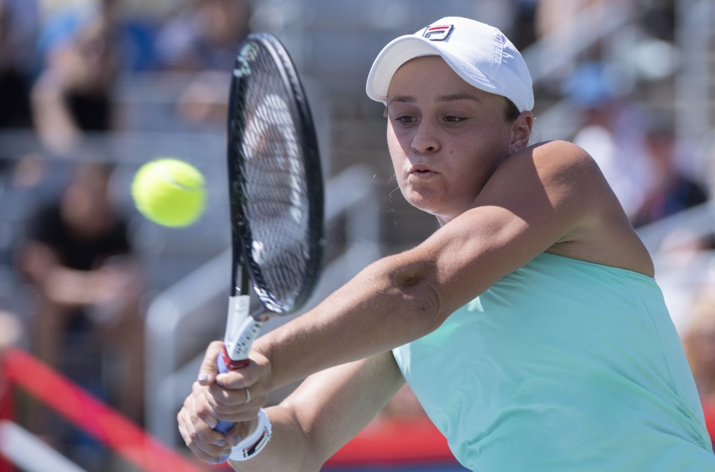 Ashleigh Barty of Australia returns to Simona Halep of Romania during semifinals play at the Rogers Cup tennis tournament Saturday, Aug. 11, 2018 in M