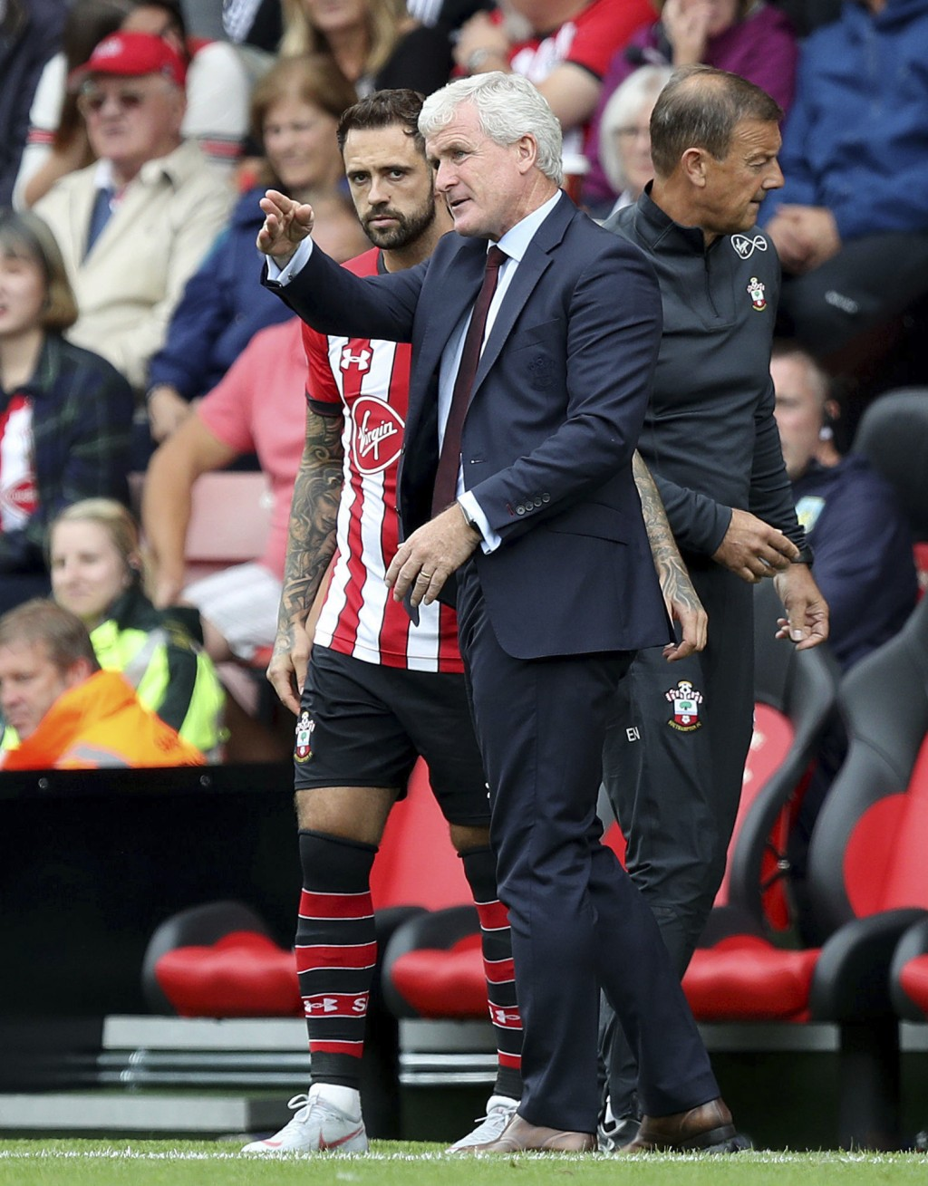 Southampton's Danny Ings takes instructions from manager Mark Hughes as he prepares to enter the game during the Premier League soccer match between S