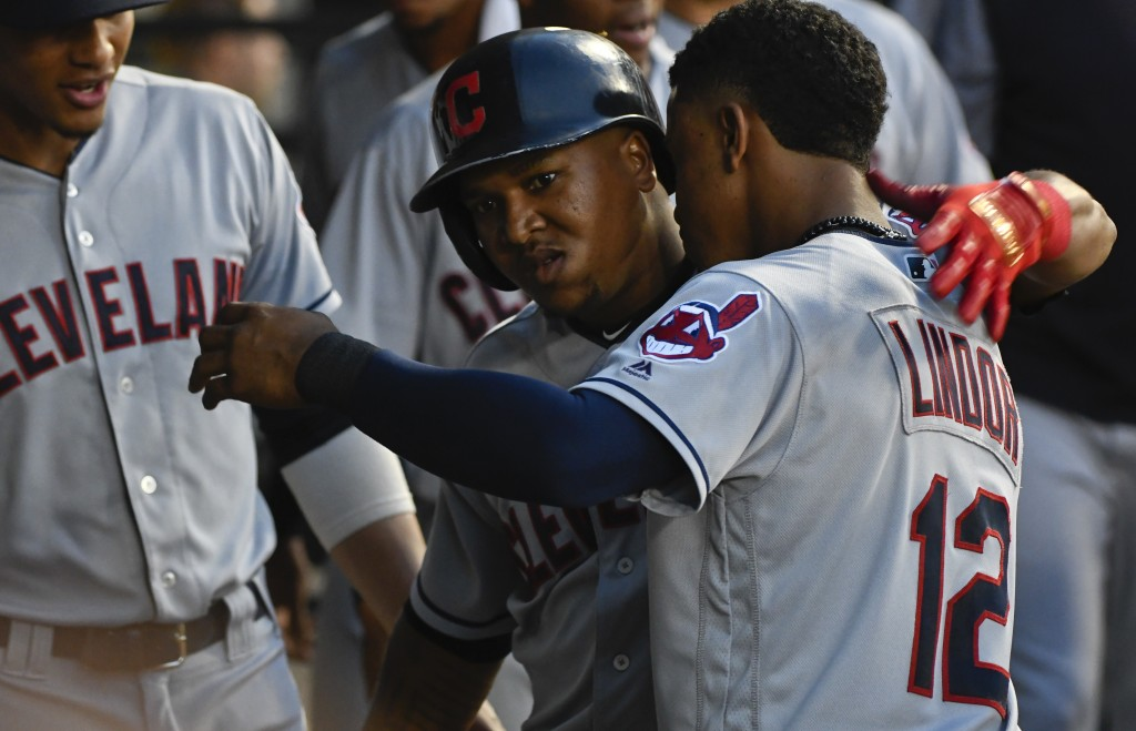 Cleveland Indians' Jose Ramirez, center, celebrates with Francisco Lindor (12) after his home run against the Chicago White Sox during the sixth innin