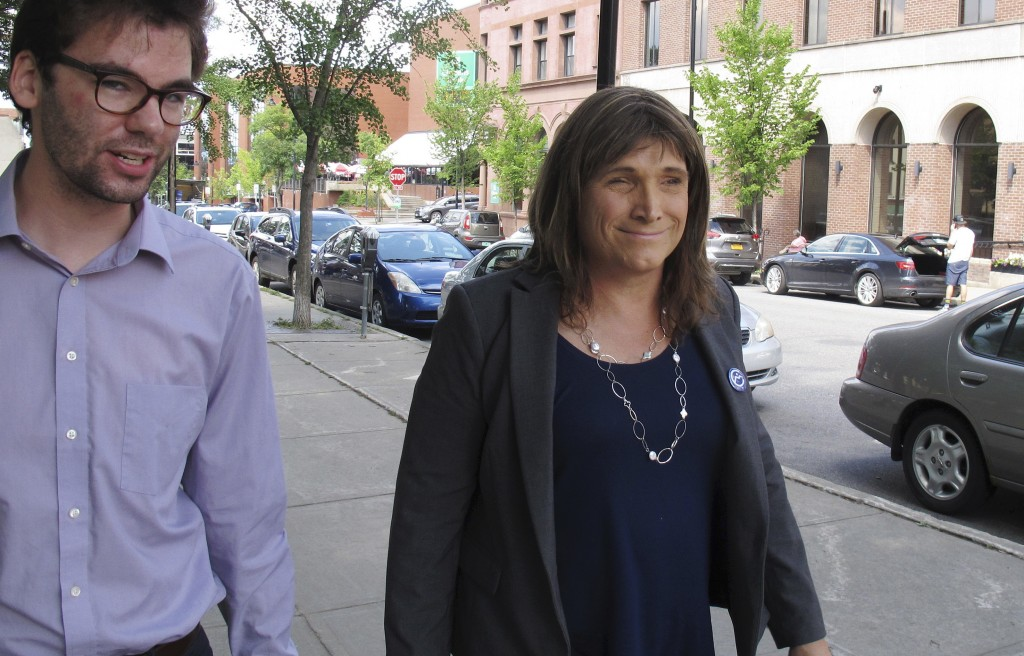 In this Aug. 9, 2018 photo, Christine Hallquist, transgender candidate seeking the Democratic party nomination to run for governor of Vermont, walks w
