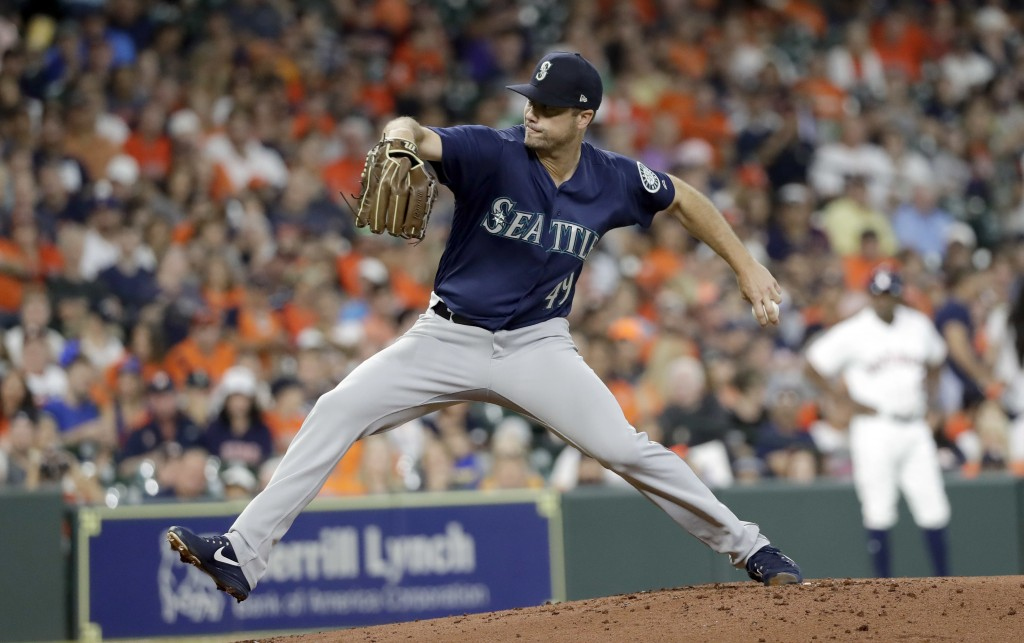 Seattle Mariners starting pitcher Wade LeBlanc throws to a Houston Astros batter during the first inning of a baseball game Saturday, Aug. 11, 2018, i