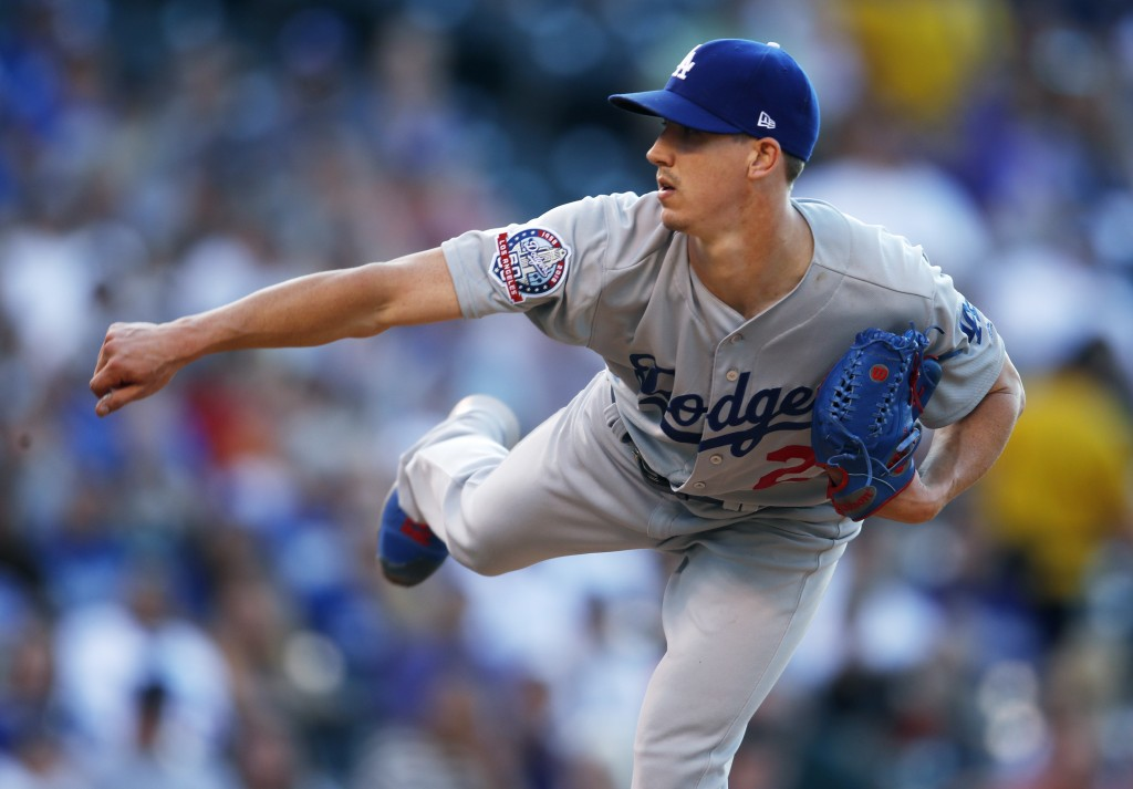Los Angeles Dodgers starting pitcher Walker Buehler works against the Colorado Rockies in the first inning of a baseball game Saturday, Aug. 11, 2018,