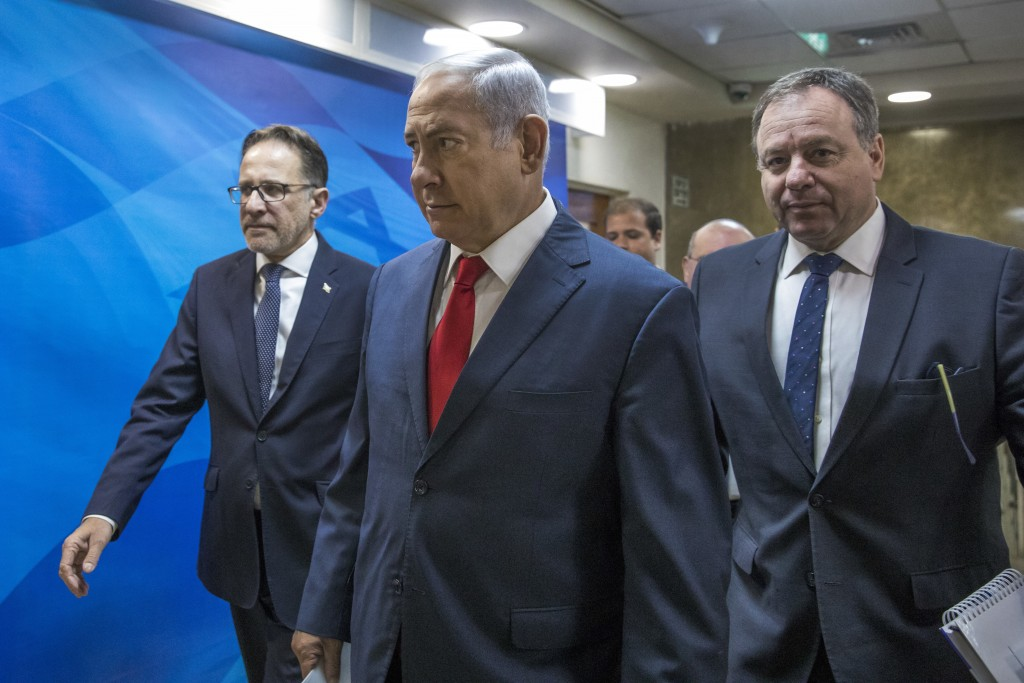 Israel Prime Minister Benjamin Netanyahu arrives for the weekly cabinet meeting in his Jerusalem office, Sunday, August 12, 2018. Netanyahu defended h