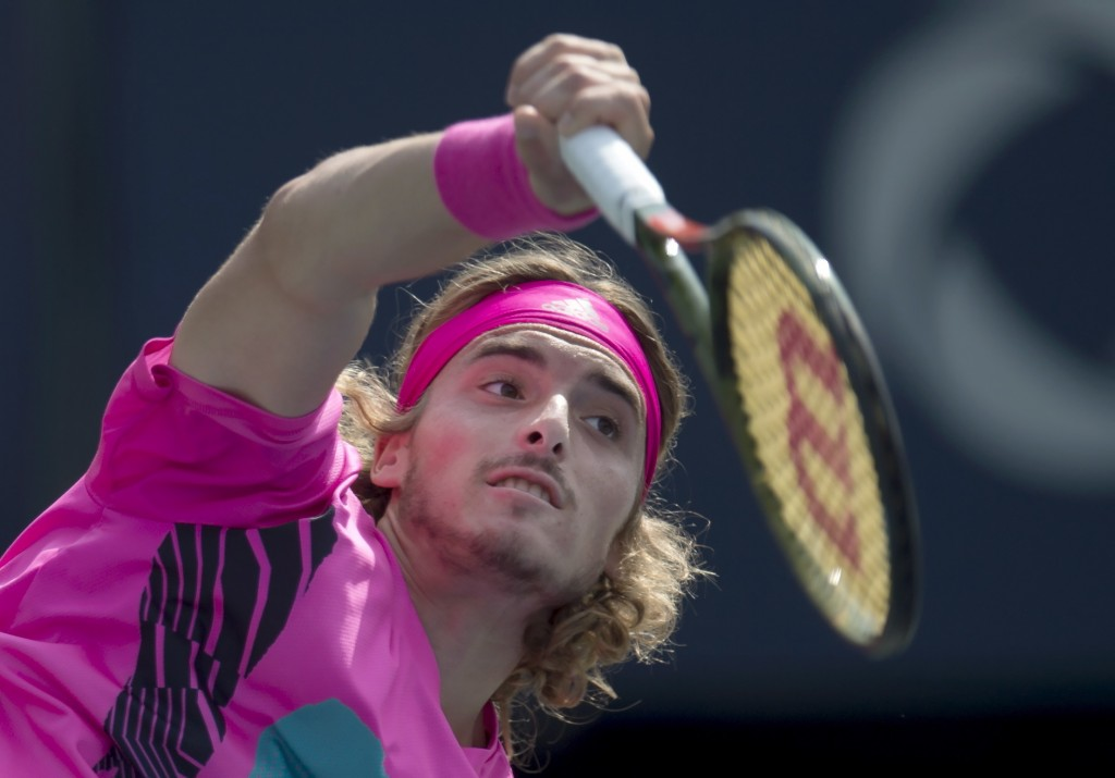 Stefanos Tsitsipas of Greece serves to Kevin Anderson of South Africa during Rogers Cup semifinal tennis tournament action in Toronto on Saturday, Aug