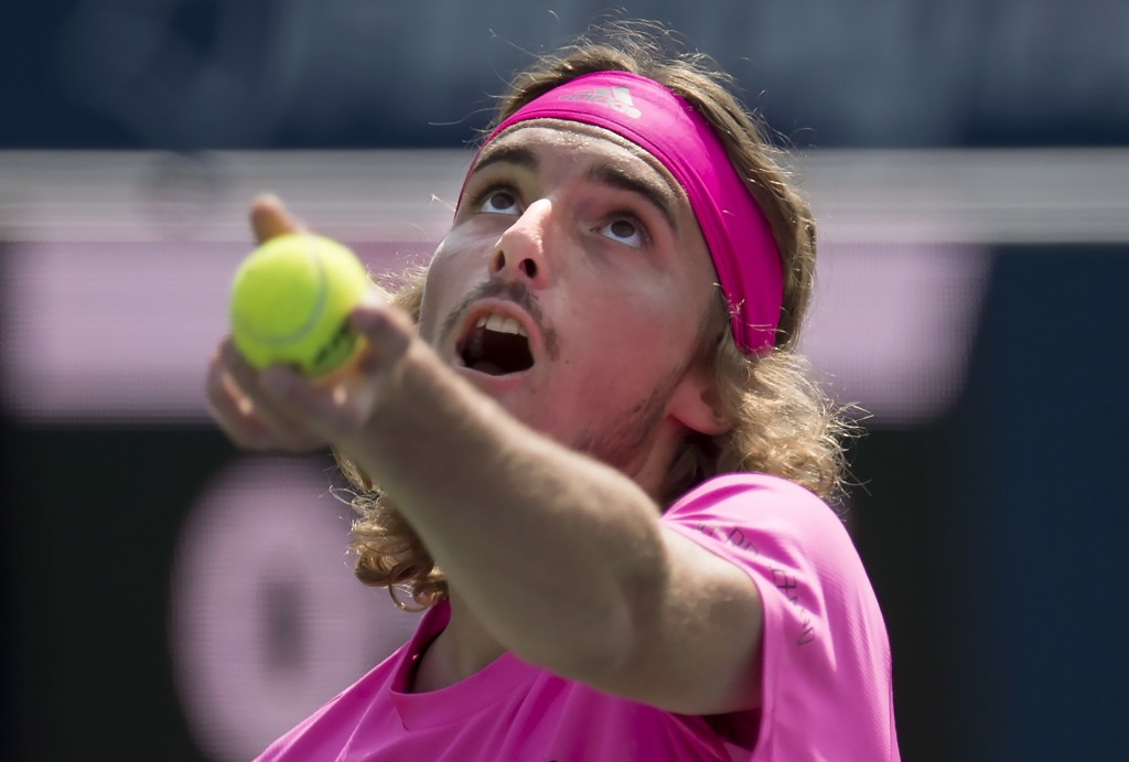 Stefanos Tsitsipas of Greece tosses the ball to serve to Kevin Anderson of South Africa during Rogers Cup semifinal tennis tournament action in Toront