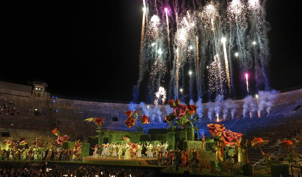 Fireworks explode during the finale of Rossini's ''Barbiere di Siviglia'' at the Verona Arena, in Verona, Northern Italy, Saturday, Aug. 4, 2018. Afte