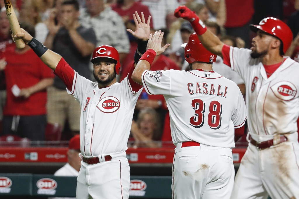 Cincinnati Reds' Eugenio Suarez (7) and Curt Casali (38) celebrate after scoring on an RBI-double by Tucker Barnhart off Arizona Diamondbacks relief p