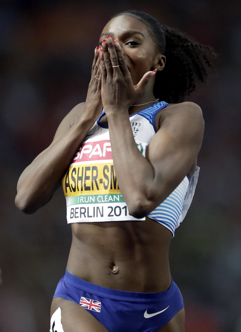 Britain's gold medalist Dina Asher-Smith celebrates winning the women's 200 meter final race at the European Athletics Championships in Berlin, German