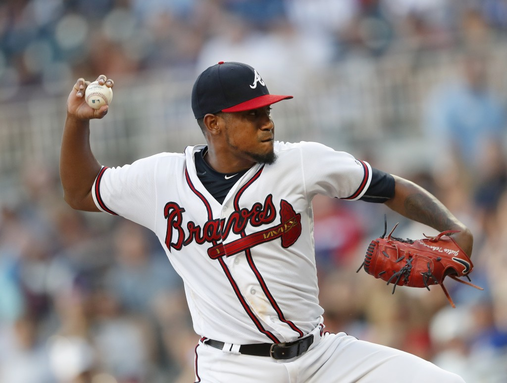 Atlanta Braves starting pitcher Julio Teheran works in the first inning of a baseball game against the Milwaukee Brewers, Saturday, Aug. 11, 2018 in A