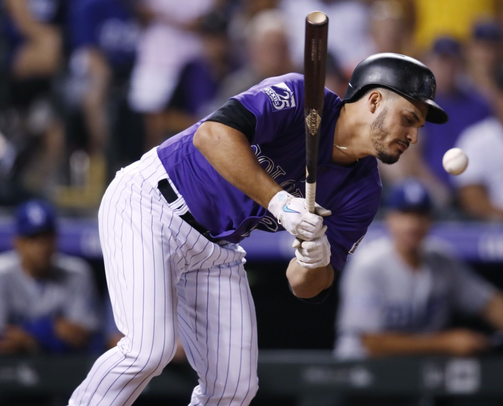 Colorado Rockies pinch-hitter Nolan Arenado reacts after beiing hit with a pitch thrown by Los Angeles Dodgers reliever JT Chargois in the ninth innin