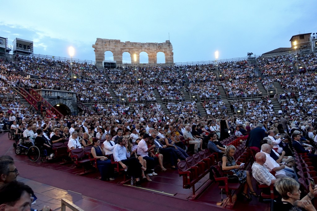 Spectators watch Rossini's ''Barbiere di Siviglia'' at the Verona Arena, in Verona, Northern Italy, Saturday, Aug. 4, 2018. After the colossal Roman-e