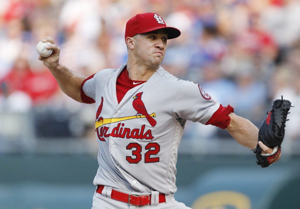 St. Louis Cardinals pitcher Jack Flaherty throws to a Kansas City Royals batter in the first inning of a baseball game at Kauffman Stadium in Kansas C