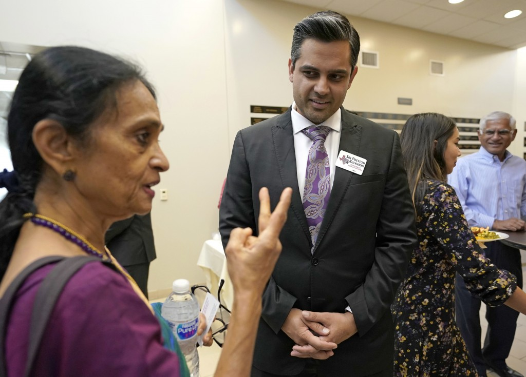 In this Sunday, July 29, 2018, photo, Thara Narasimhan, left, talks with Democrat for Congress candidate Sri Kulkarni during a fundraiser in Houston.