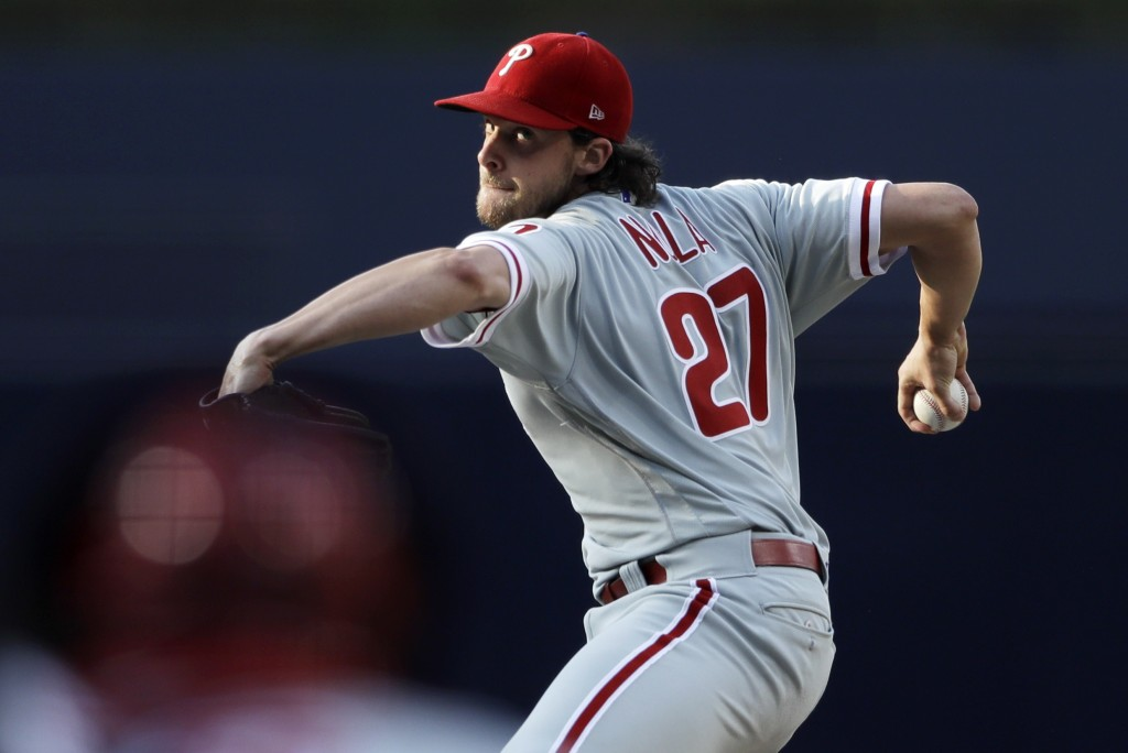 Philadelphia Phillies starting pitcher Aaron Nola works against a San Diego Padres batter during the first inning of a baseball game Saturday, Aug. 11