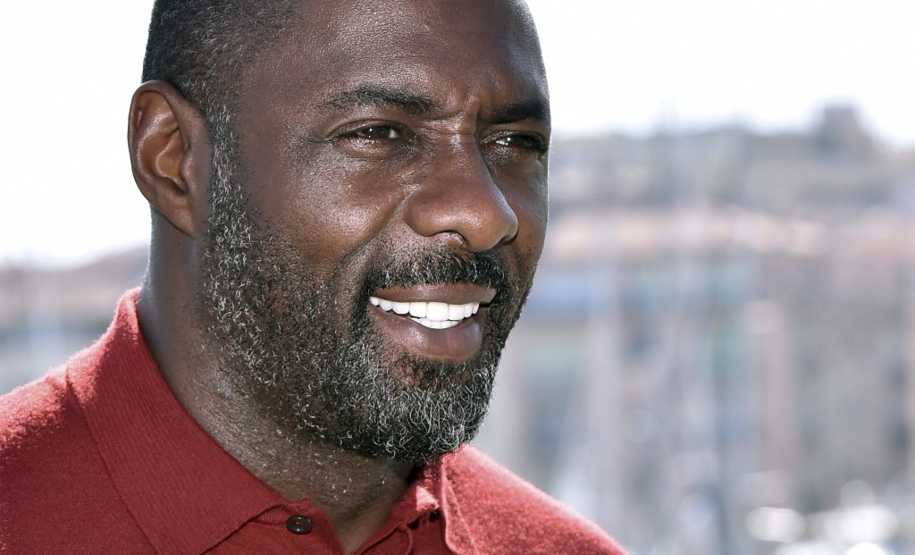 FILE - In this file photo dated Tuesday, April 14, 2015, actor Idris Elba poses for photographers during the MIPTV, International Television Programme