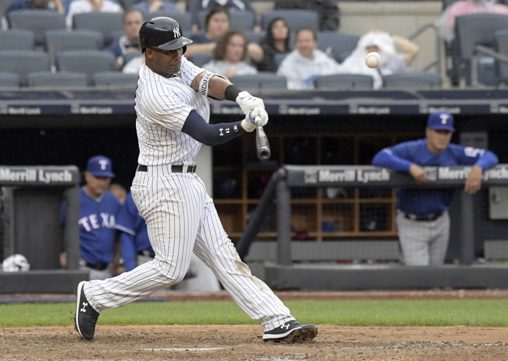 New York Yankees' Miguel Andujar hits a two-run home run during the seventh inning of a baseball game against the Texas Rangers Saturday, Aug. 11, 201