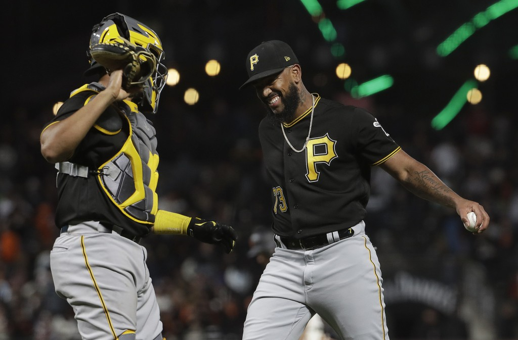 Pittsburgh Pirates catcher Elias Diaz, left, and pitcher Felipe Rivero celebrate after the Pirates defeated the San Francisco Giants 4-0 in a baseball