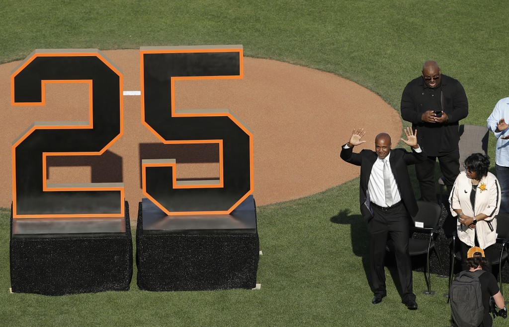 Former San Francisco Giants player Barry Bonds waves to fans next to his mother, Pat, as he is honored during a ceremony to retire his jersey number b