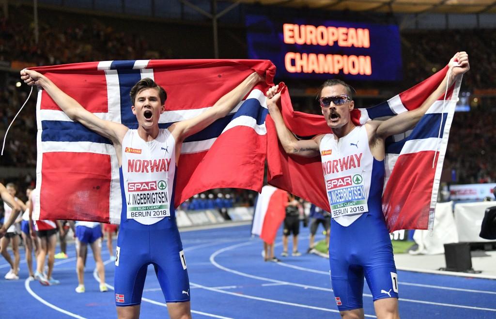 Norway's gold medal winner Jakob Ingebrigtsen, left, and silver medal winner Henrik Ingebrigtsen celebrate after the men's 5000-meter final at the Eur