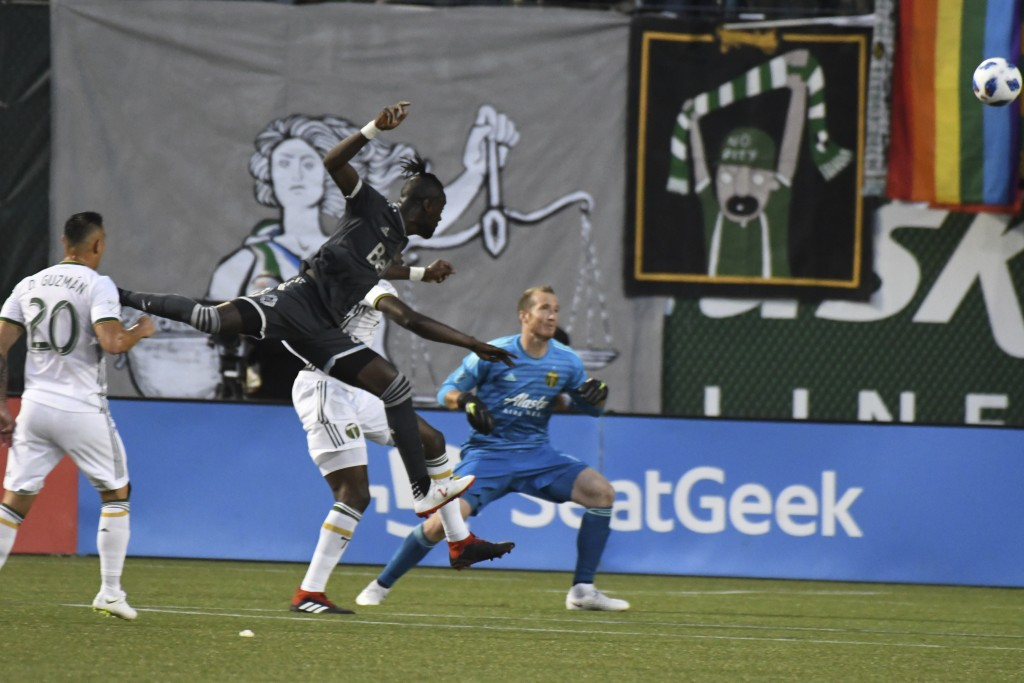 Vancouver Whitecaps' Kei Kamara (23) scores on a header against the Portland Timbers during an MLS soccer match Saturday, Aug. 11, 2018, in Portland,