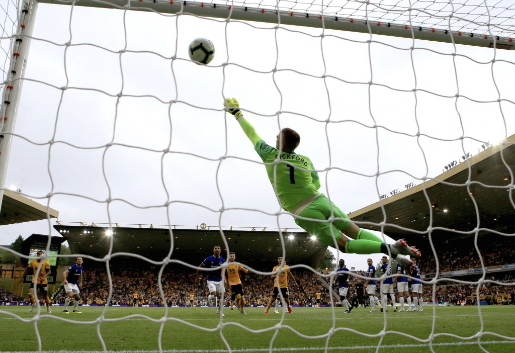 Everton goalkeeper Jordan Pickford fails to stop the ball as Wolverhampton Wanderers' Ruben Neves scores his side's first goal of the game during thei