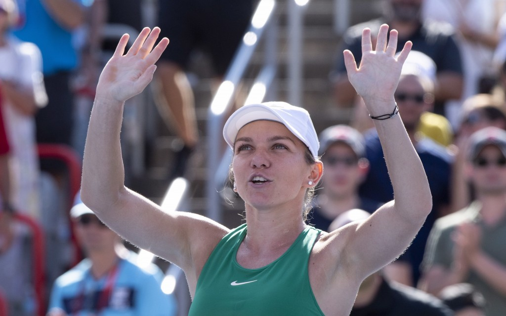 Simona Halep of Romania celebrates after beating Sloane Stephens of the United States in the final at the Rogers Cup tennis tournament Sunday, Aug. 12