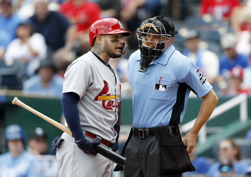 St. Louis Cardinals' Yadier Molina, left, argues with home plate umpire Adam Hamari after being called out on a pitch from Kansas City Royals pitcher