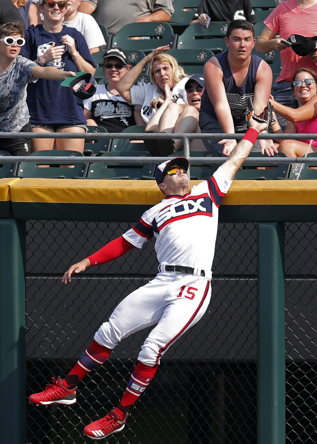 Chicago White Sox's Adam Engel (15) makes a catch against the wall for an out on a ball hit by Cleveland Indians' Yonder Alonso during the eighth inni
