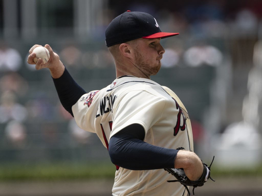 Atlanta Braves' Sean Newcomb pitches against the Milwaukee Brewers during the first inning of a baseball game Sunday Aug. 12, 2018, in Atlanta. (AP Ph
