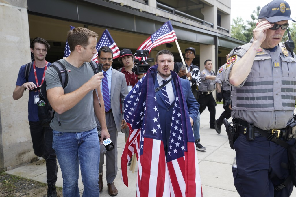 White nationalist Jason Kessler arrives at the Vienna metro station in Vienna, Va., Sunday, Aug. 12, 2018. White nationalists are gathering there to t...