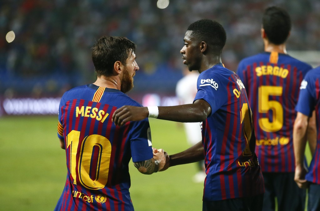 Barcelona's Ousmane Dembele celebrates with Lionel Messi, left, after scoring his side's second goal during the Spanish Super Cup soccer match between...