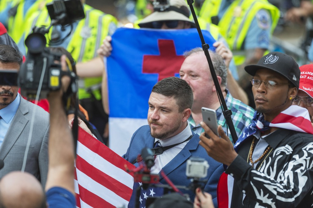 "Jason Kessler, center, marches with other white nationalists to Lafayette Square during the ""Unite the Right 2"" rally in Washington, Sunday, Aug. 12,"