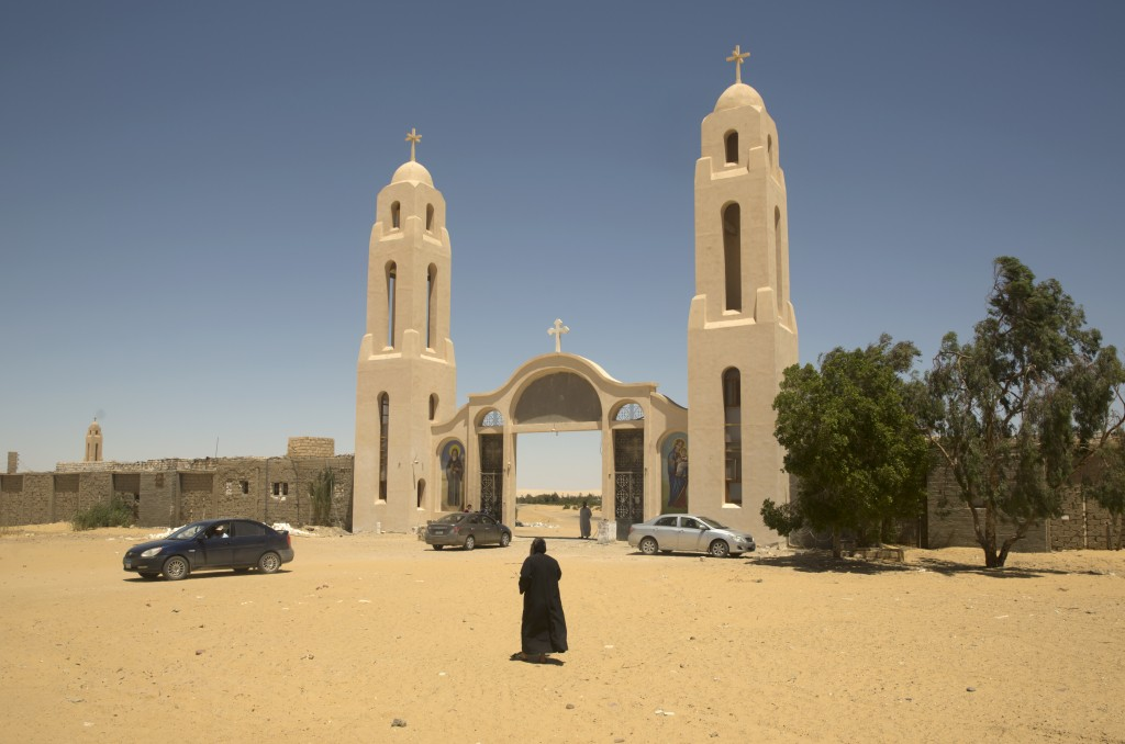 FILE - In this May 27, 2017 file photo, a priest walks in front of St. Samuel the Confessor Monastery in Maghagha, Egypt. The killing of a respected b...