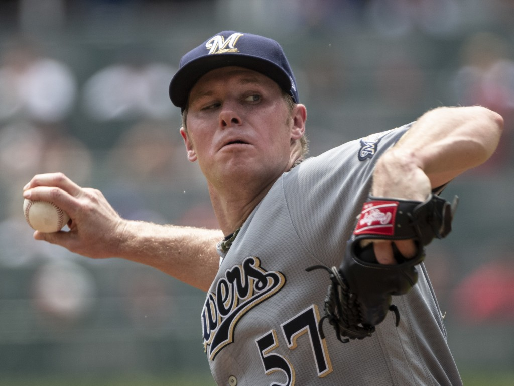 Milwaukee Brewers' Chase Anderson pitches against the Atlanta Braves during the first inning of a baseball game Sunday Aug. 12, 2018, in Atlanta. (AP