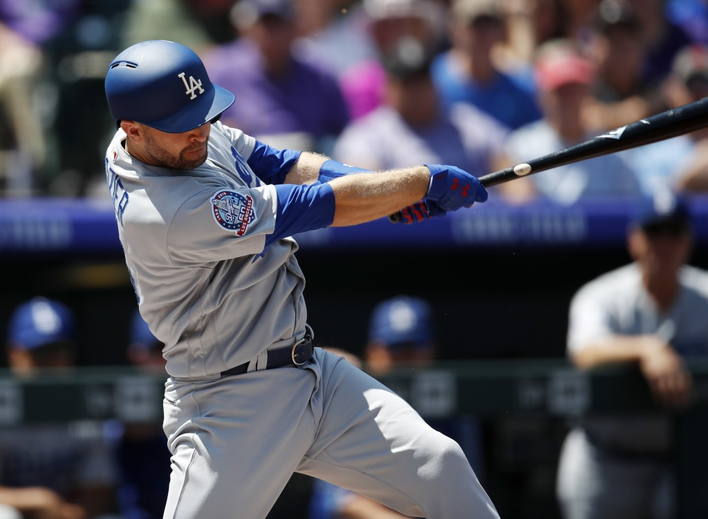 Los Angeles Dodgers' Brian Dozier singles off Colorado Rockies starting pitcher Chad Bettis in the first inning of a baseball game Sunday, Aug. 12, 20
