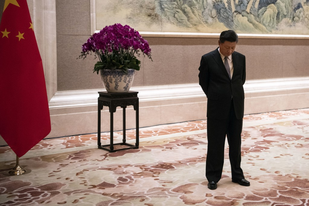 FILE - In this June 21, 2018, file photo, China's President Xi Jinping waits for the arrival of Papua New Guinea Prime Minister Peter O'Neill prior to...