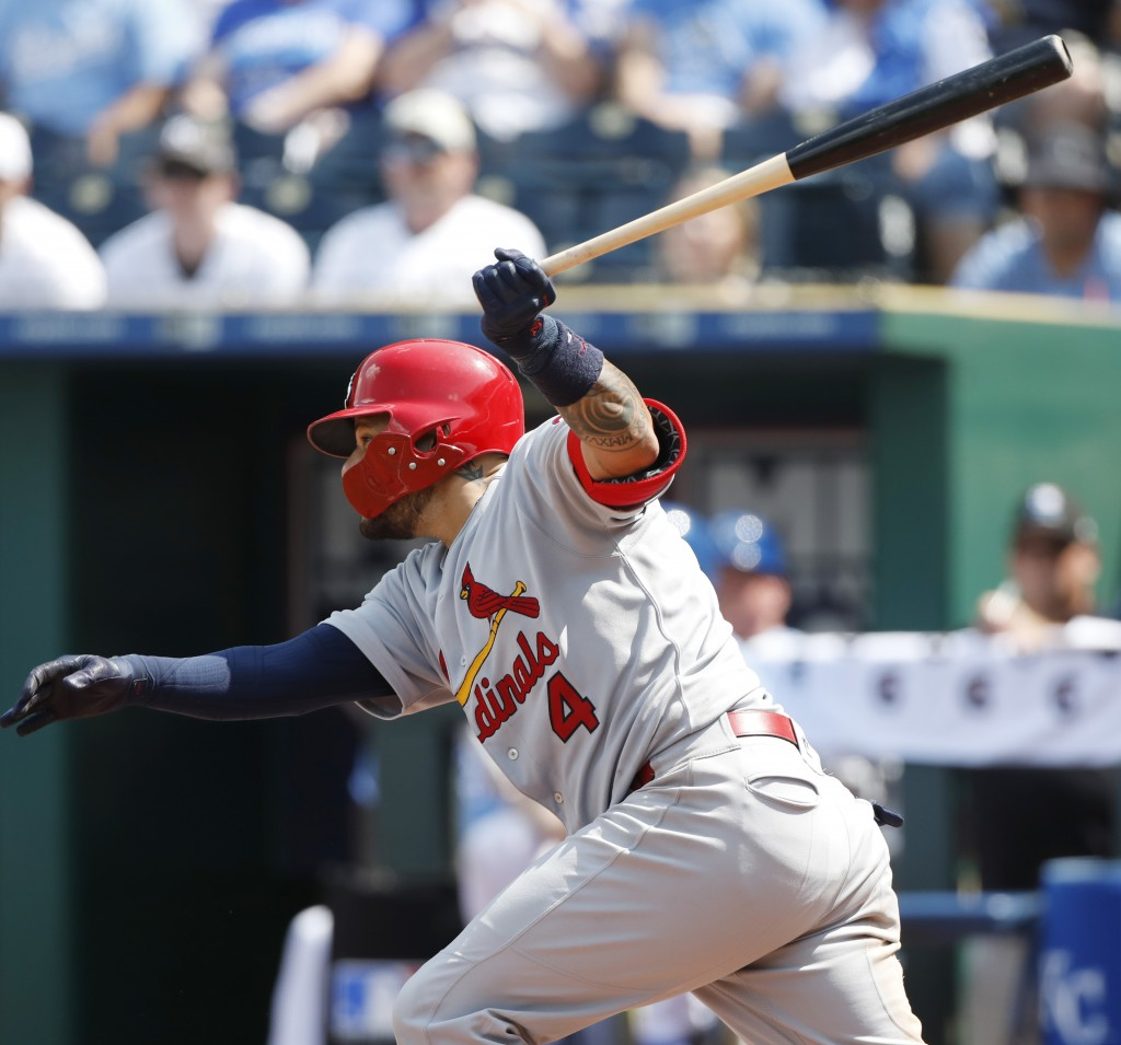 St. Louis Cardinals' Yadier Molina hits a two-run single in the seventh inning of a baseball game against the Kansas City Royals at Kauffman Stadium i