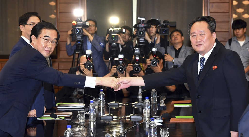 South Korean Unification Minister Cho Myoung-gyon, left, shakes hands with his North Korean counterpart Ri Son Gwon during their meeting at the northe...