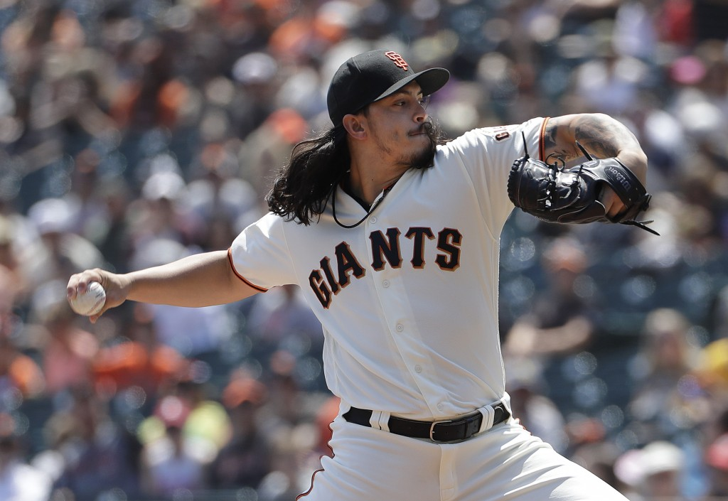 San Francisco Giants pitcher Dereck Rodriguez throws against the Pittsburgh Pirates during the first inning of a baseball game in San Francisco, Sunda...