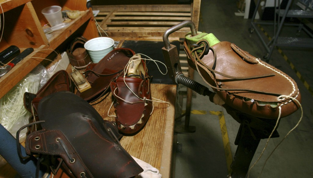 FILE - This Aug. 11, 2010, file photo, shows shoes at the research and development room of Timberland Company in Stratham, N.H. VF Corp. says it plans...