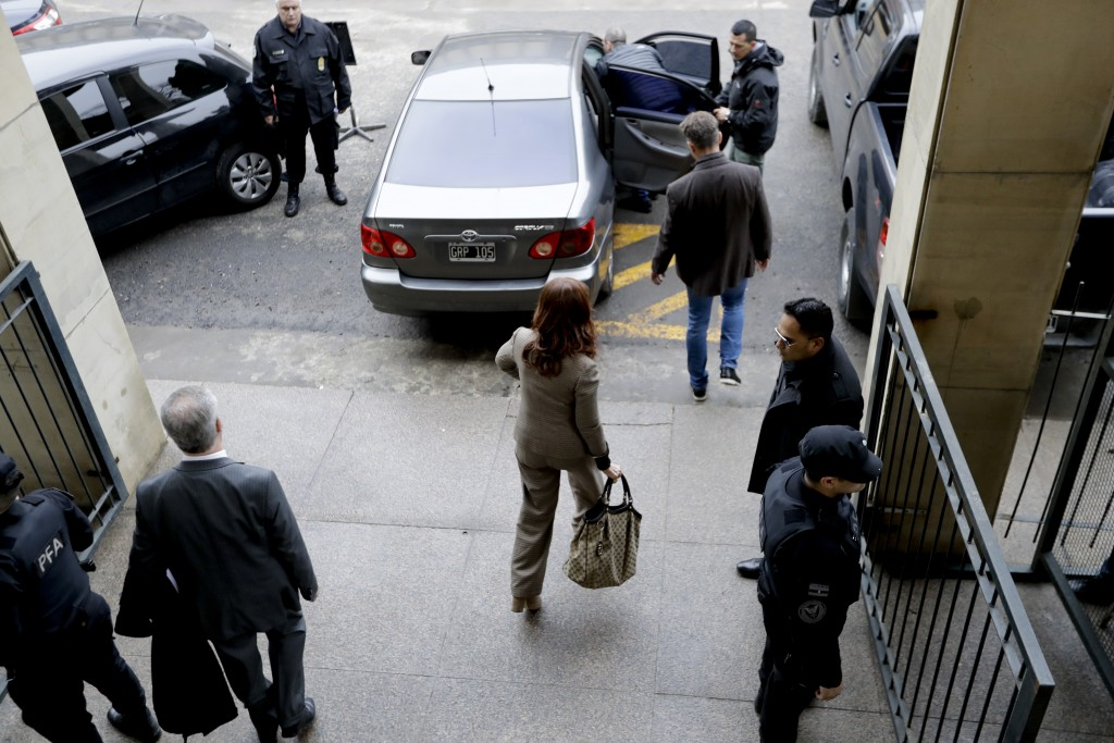 Former President Cristina Fernandez leaves a court hearing after presenting a brief in which she claims that she is wrongly accused in an investigatio...