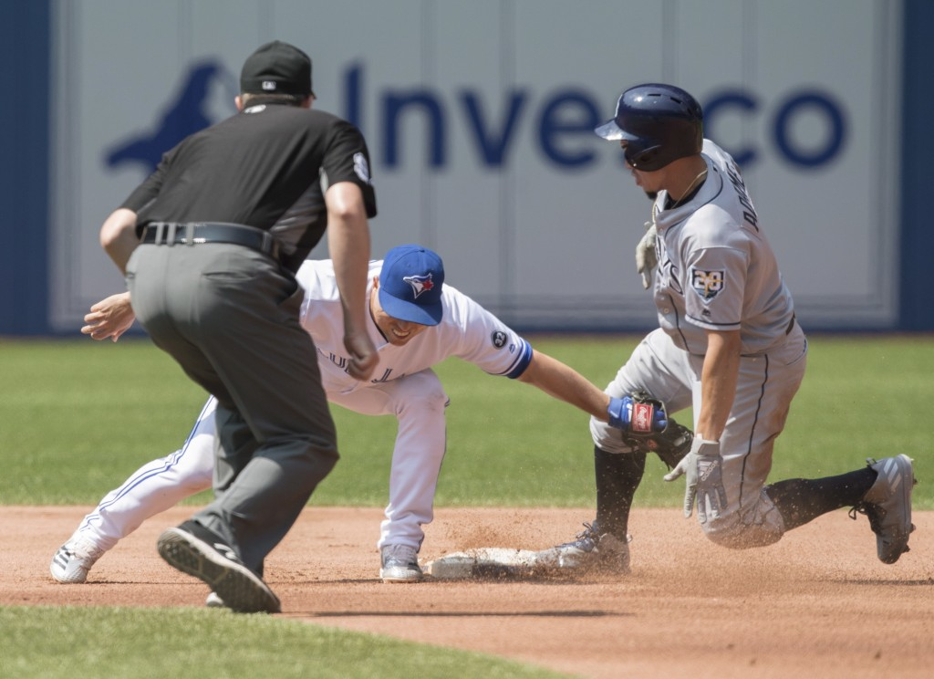 Tampa Bay Rays' Willy Adames safely steals second beating the tag attempt by Toronto Blue Jays shortstop Aledmys Diaz in the fourth inning of a baseba
