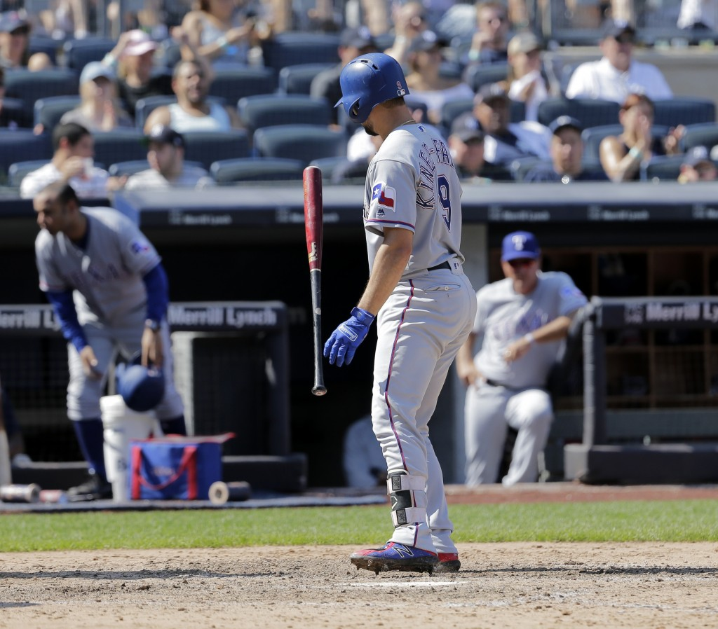 Texas Rangers' Isiah Kiner-Falefa reacts after striking out with the bases loaded during the eighth inning of a baseball game against the New York Yan